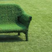 Eco style of interior decoration the grass sofa with green grass floor Stock Photos