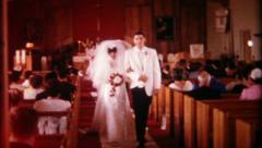 1186 - newlyweds walk down the isle - vintage film home movie - stock footage