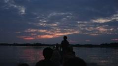 Sunset on a motorized canoe Stock Footage