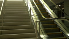 Woman walking up stairs at a mall 4k Stock Footage
