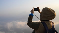 Asian woman taking photos of beautiful panoramic view in Annapurna mountains Stock Footage