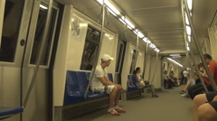 Travel by subway train, people on sits wait next station arrival fastest vehicle Stock Footage