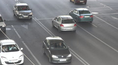 Car traffic under bridge, congestion at rush hour, cars drive in central city - stock footage