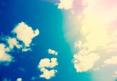 Blue sky with sun and clouds Stock Photos