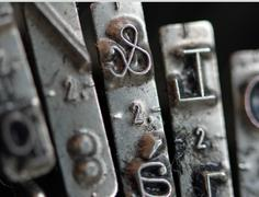detail of ampersand key in an old mechanical typewriter - stock photo