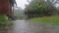 Monsoon in rainforest village with flooding ground Stock Footage