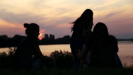 Stock Video Footage of Young mother with baby at the lake at sunset.