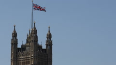 Parliament Houses Palace of Westminster National Flag Royal Banner Union Jack UK - stock footage