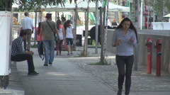 People walking relaxed in sunny day summer clothing young persons step, sidewalk Stock Footage