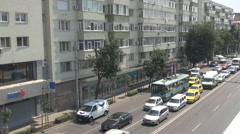 Crowded traffic lanes, cars and public trolleybus drive in column, above view Stock Footage