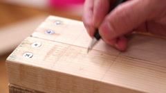 Carpenter mark holes and drill wood planks Stock Footage