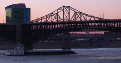 Small barge travels under a bridge along the Mississippi River near St. Louis. - stock footage