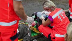 Reanimate injured person, Paramedic in action Stock Footage