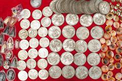 Stock Photo of old cheap souvenir coins for sale at asian market. laos
