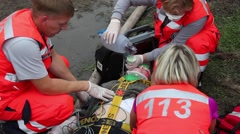 Reanimate injured person, Paramedic in action - stock footage