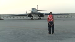 Rockwell B-1 Lancer bomber aircraft and marshaller Stock Footage