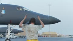 Rockwell B-1 Lancer bomber aircraft marshalling Stock Footage