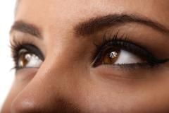 closeup shot of woman eyes with day makeup - stock photo
