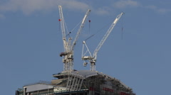 London City Construction Cranes Modern Building Under Construction Blue Sky UK Stock Footage