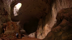 Prohodna cave in Bulgaria with two eye-like holes in its ceiling Stock Footage