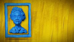 Animated Einstein bust in frame on grange yellow background. Stock Footage