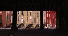 Tenements houses under an overpass in an American city. Stock Footage