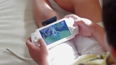 Boy Play PlayStation Portable on the Couch Stock Footage