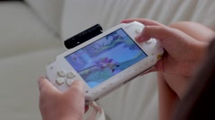 Hand on a Sony PlayStation Portable Stock Footage