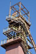 Mine shaft against blue sky Stock Photos