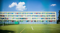 Timelapse of clouds in sky over school and sports ground Stock Footage