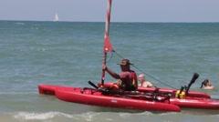 Kayak trimaran prepares to sail Stock Footage