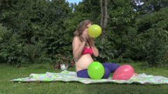Pregnant woman girl inflate colorful balloons. Fun pregnancy Stock Footage