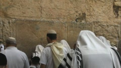 Many religious Jews in traditional white praying near Western Wall Stock Footage