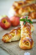 baked braided pigtails with apples - stock photo