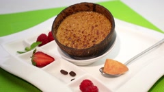 Creme brulee in coconut shell - stock footage