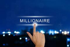 Hand pushing millionaire button on touch screen Piirros