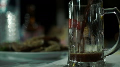 Pouring dark beer into glass mug Stock Footage