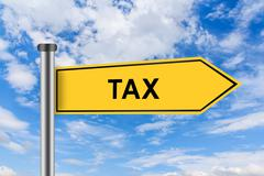 Yellow road sign with accounting tax words Stock Photos