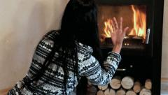 Woman gives wood in the stove Stock Footage