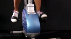 Close up of a young woman riding stationary bike Stock Footage
