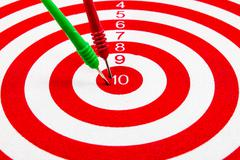 red dart target with red and green arrows  close up - stock photo