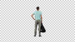 Man standing with bag on alpha matte (back view) - stock footage