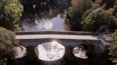 Fly over Romantic River and Bridge Stock Footage