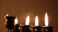 Beautiful lit hanukkah menorah on dark abstract background Stock Footage