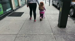 Girl and Mother Walking Streets of New York City Stock Footage