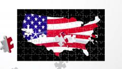 Puzzle pieces fly in and form a map of the USA with a billowing stars and stripe Stock Footage