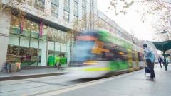 Timelapse video of commuters in a busy tram station in Melbourne Stock Footage
