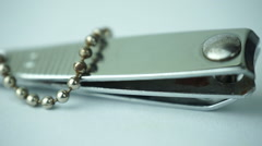 Stainless steel metal nail clipper. Camera rotation surrounding the object. Stock Footage