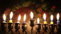 Beautiful lit hanukkah menorah on dark abstract background - stock footage