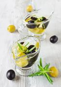 appetizing olive oil with olives - stock photo